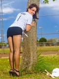 Sexy MILF in baseball uniform and black pantyhose getting stripped on the court