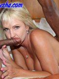 Mommy gets the best of a very big black cock in her carefully shaven fuck hole