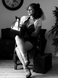 Busty MILF gets rid of her vintage outfit nice and slow on black-and-white pics