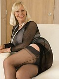 Ravishing mature blonde posing in a sexy nylon outfit that reveals her delicious tits
