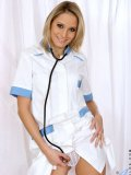 Thirty-something-year-old nurse Leticia slides out of her sexy uniform on camera