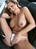 Fit MILF posing next to and getting all naked in a swanky vintage convertible