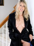 This blond mommy wearing nothing under her black coat is a real exhibitionist