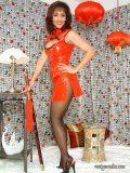Naughty brunette housewife posing in a hot latex outfit and playing with a huge sword