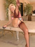 Blond MILF wearing no panties slides a stocking off her leg so damn seductively
