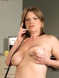 Busty mature office slut Randi Layne enjoys cock in her mouth and rides it on her desk