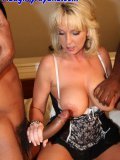 Naughty cougar with big jugs agrees to handle two oversized black dicks at once