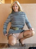 Mature blondie spreads her stockinged legs and slides out of her black thongs
