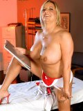 Tattooed mature nurse playing with an anal thermometer and monstrous glass dildo