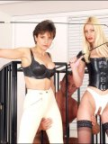 Lady Sonia and her kitty friend team up on poor caged slave squashing his cock