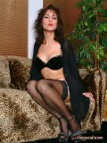 Gorgeous brunette milf loves to show off her long legs in sexy black nylons