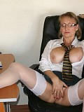 Watch a horny busty milf pose in a sexy black lingerie while playing with a dildo