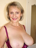 Horny Michelle loves to flaunt her incredible big boobs in satin lingerie