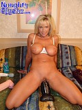 This incredible blonde bitch manages to stretch her big pussy just enough to sit on an insanely massive dildo