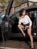 Raunchy older lady flashes her stockings teasingly when stepping out of her car