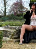 Mommy shows all most intimate nooks of her body on cam during a walk in the park