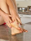 Raunchy mature doll Lilli rubs cream into her amazingly beautiful pedicured feet