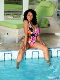 Stacked Latin mommy gets rid of her tight monokini and shows body by the pool