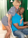 A mature housewife impales herself on a big black cock by going balls deep
