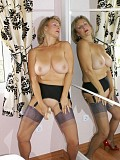 Naughty blonde milf loves to fuck herself with a thick dildo while posing in stockings