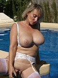 Gorgeous Michelle shows off her magnificent tits and pussy by the pool