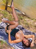 Horny brunette housewife goes out by the river to pose in her sexy stockings
