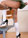 Hot mature milf posing in naughty schoolgirl clothes flashing her sexy nylons