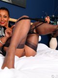 Juicy mature busty in corset and stockings impales herself on a rubber shlong