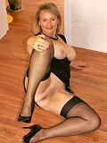 Gorgeous blonde mature milf teases posing in sexy black lingerie and stockings
