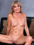 Mom Jessica Sexxxton looks plain classy wearing nothing but her opaque stockings
