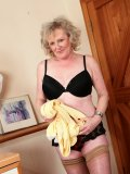 Sexy granny gets rid of all her clothes immediately after crossing the threshold