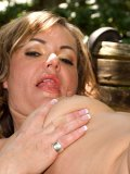 Juicy MILF Kelly Leigh poses nude outdoors and plays with a string of anal beads