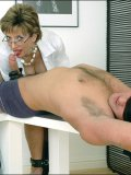 Bound and blindfolded dude gets a blowjob from a very hot MILF in rubber gloves