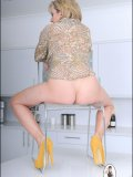 Lady Sonia shows her ripe pussy and tight asshole through a transparent chair