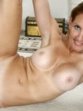 Beautiful mature lady takes off her clothes piece by piece till she is nude on the floor!