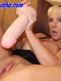 Blond mommy uses enormous sex toys stretching her wet pussy out wider and wider