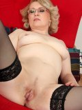 Sexy old doll spreads her stockinged legs wide showing her nice-sized pussy lips