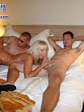 Amazing pictures of a horny blonde sandwiched between two horny guys and fucked good