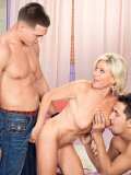 This naughty blonde housewife gets pinned between two studs hard cocks