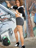 Sexy MILF poses nude next to a classy graffiti without the fear of being caught