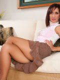 Slutty brunette housewife lifts her short skirt up to reveal her amazing ass in nylons