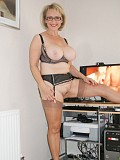 Horny blonde milf Michelle posing in her sexy stockings just for your pleasure