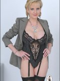 Look at the sexy black lingerie hiding under serious mature businesswomans suit