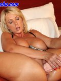Stacked blondie rams enormously thick toys into her shaven cunt making it gape