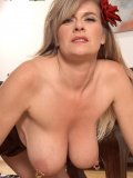 Seductive lady exposes her tits and then pours the milk all over her boobs! Yummy!