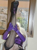 Wild mature blonde posing in seductive purple lingerie with a matching dildo