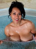 Ripe brunette mom with nice big curves relaxing in a hot tub in front of camera