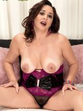 Alesia poses for the camera by exposing her plump and natural MILF titties
