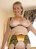 Incredibly hot pictures of a blonde Michelle flaunting her sexy body in yellow stockings