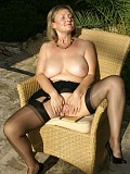Gorgeous blonde milf enjoys an afternoon of playing with her pussy outdoors